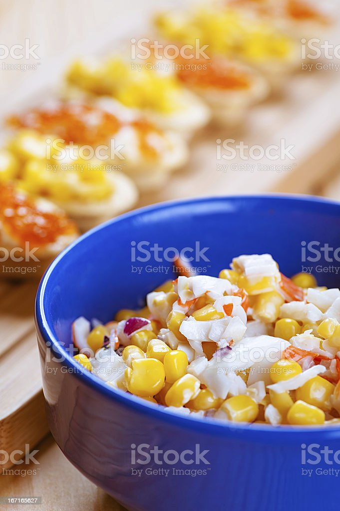 Salad with corn in blue plate royalty-free stock photo