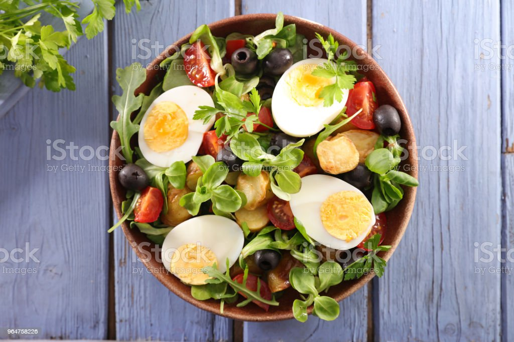 salad with egg, tomato, potato and olive royalty-free stock photo