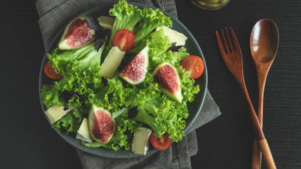 salad with figs cheese and tomatoes, vegetable dish - fig salad imagens e fotografias de stock