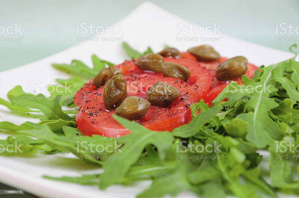 Salad With Fresh Tomatoes, Capers And Arugula royalty-free stock photo