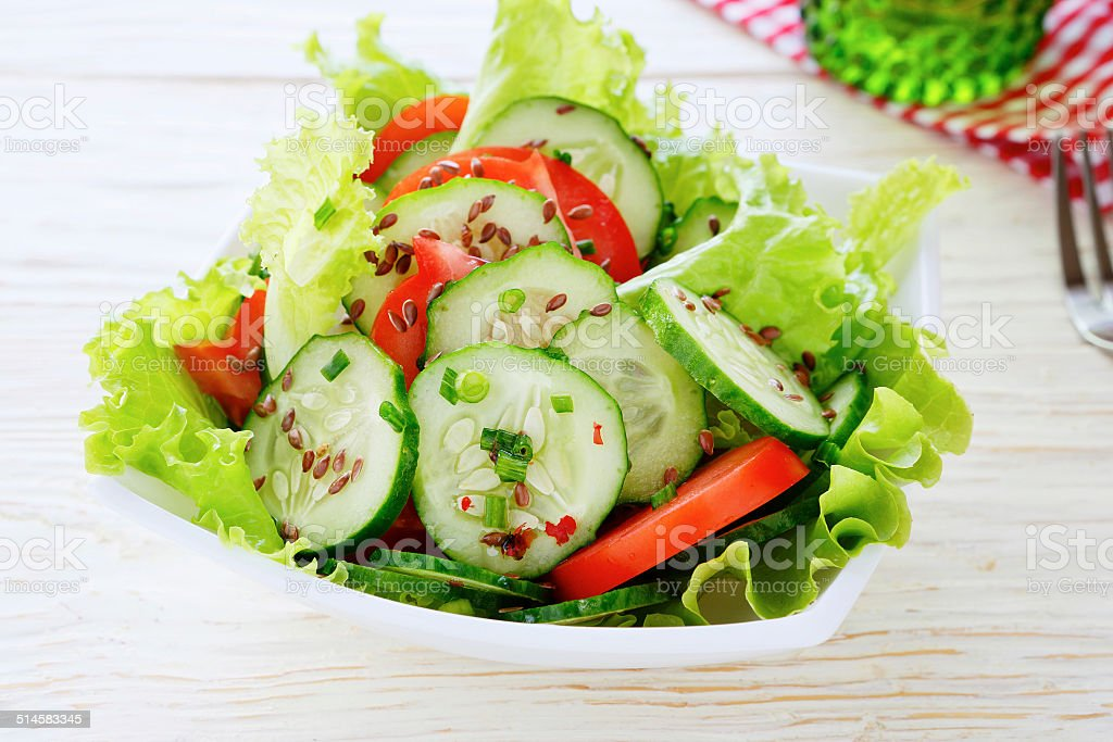 salad with fresh vegetables in bowl stock photo