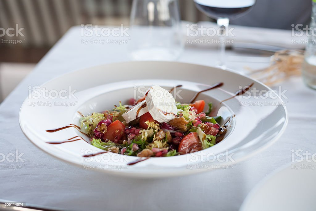 salad with goat cheese in restaurant stock photo