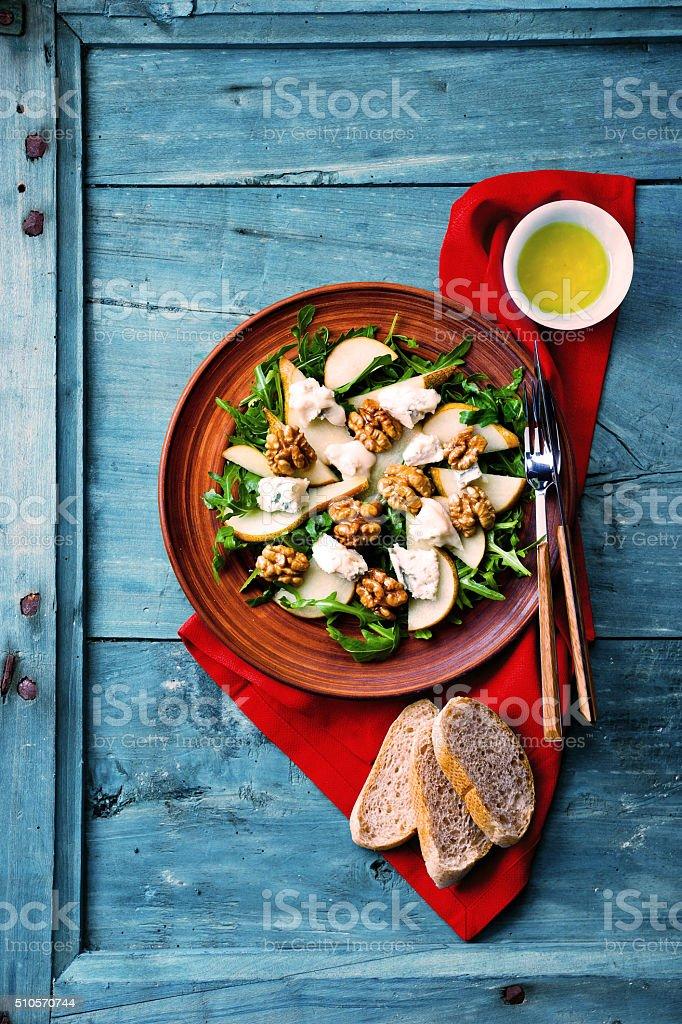 salad with gorgonzola, arugula, walnuts and pear stock photo