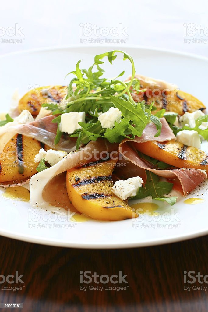 salad with grilled peach and ham royalty-free stock photo