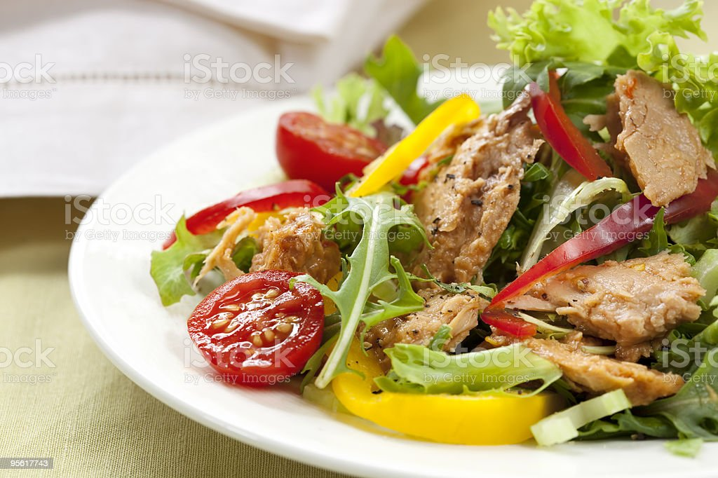 Salad with lettuce, tomato, peppers and tuna stock photo