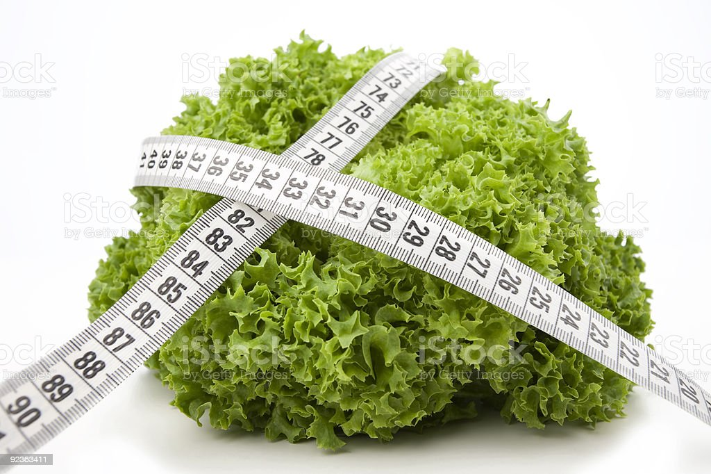 Salad with Measuring Tape royalty-free stock photo