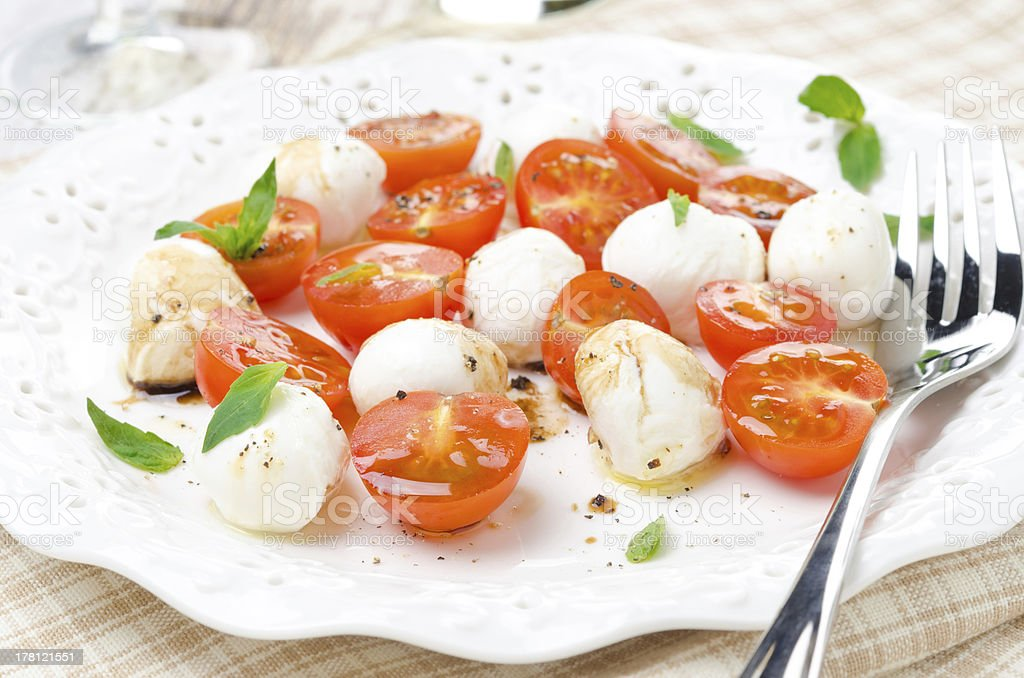 salad with mini mozzarella, cherry tomatoes royalty-free stock photo
