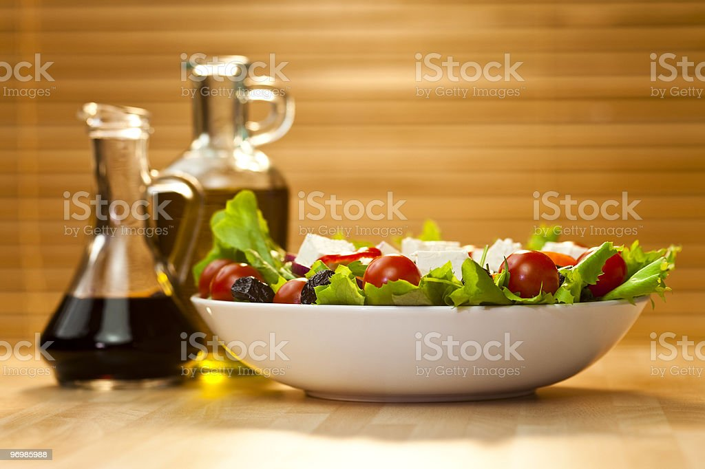 Salad With Olives, Cheese, Olive Oil and Balsamic Vinegar Dressing royalty-free stock photo