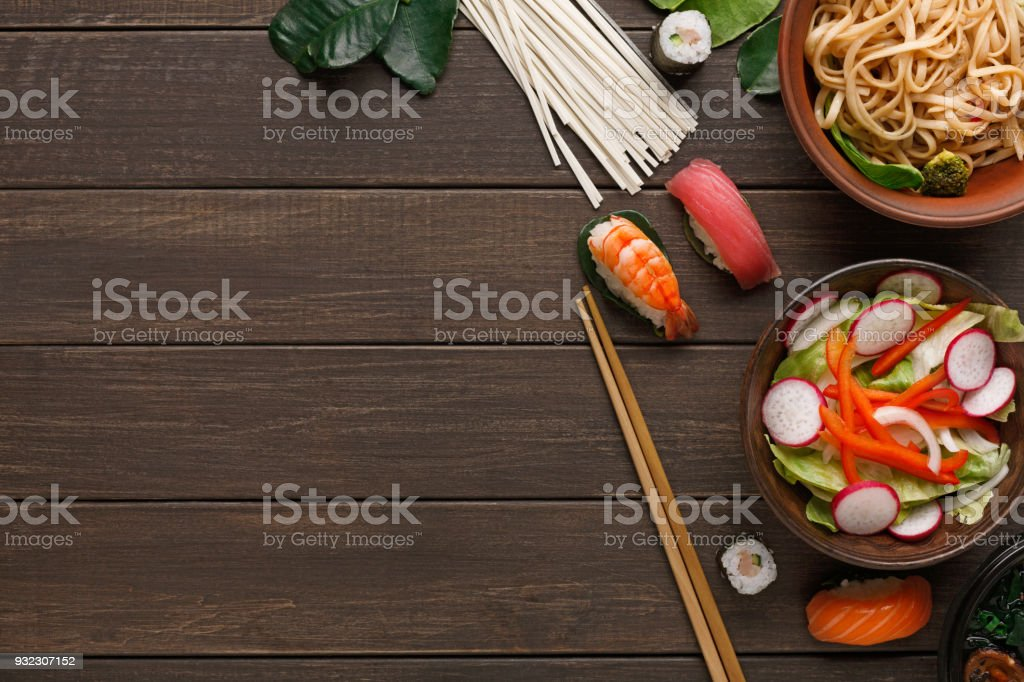 Salad with onion, pepper and radish on wooden background stock photo