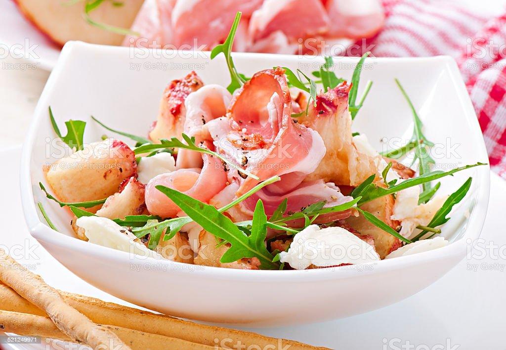 Salad with peach, mozzarella cheese and ham stock photo