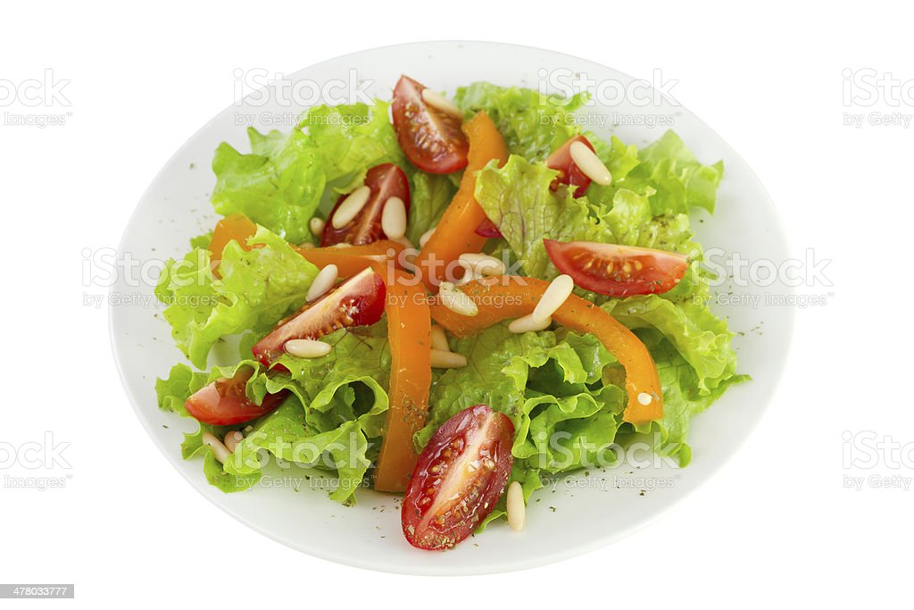 salad with pine nuts on the plate royalty-free stock photo
