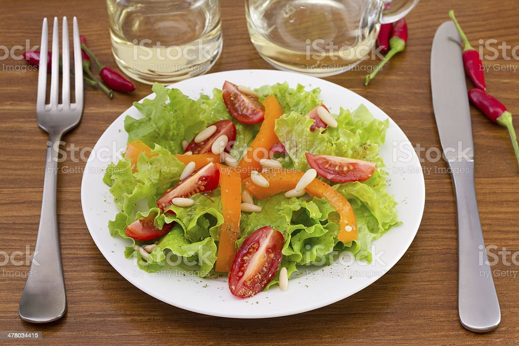salad with pine nuts on the white plate royalty-free stock photo