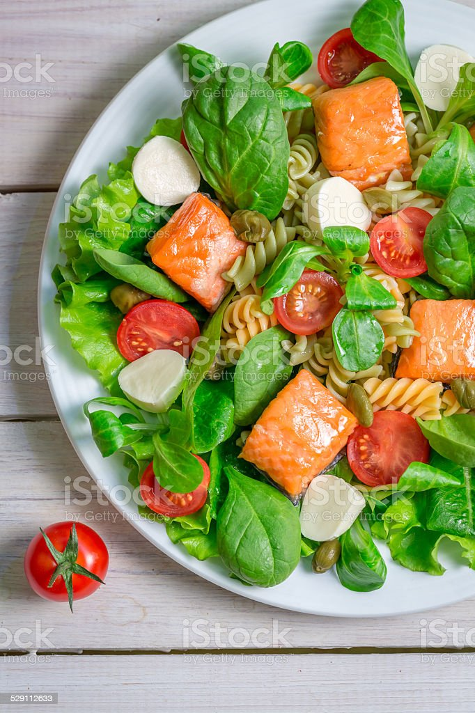 Salad with salmon and fresh vegetables stock photo
