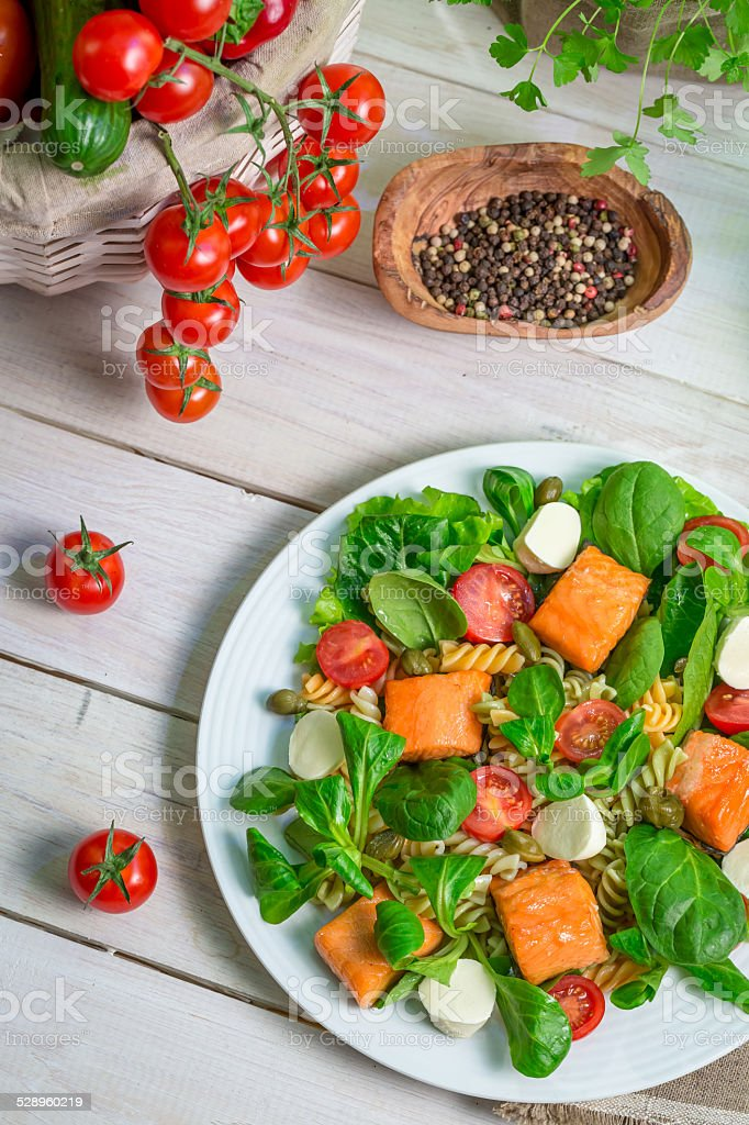 Salad with salmon and vegetables stock photo