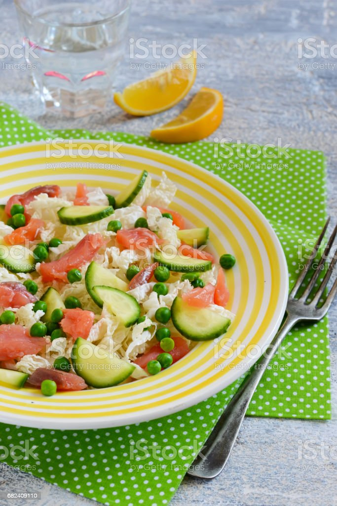 Salad with salmon, cucumber and green pepper on a concrete background.Ogranik food royalty-free stock photo