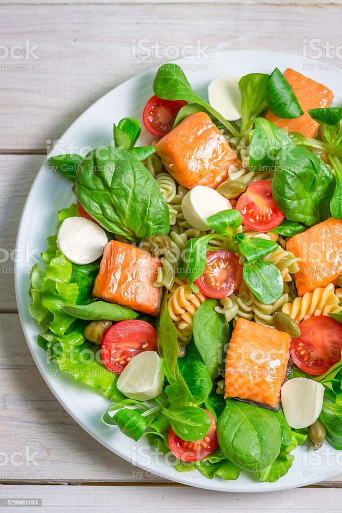 Salad with salmon, spinach and mozzarella stock photo