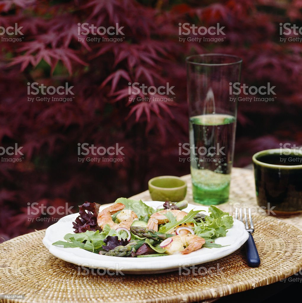 Salad with shrimp and asparagus outdoors royalty-free stock photo