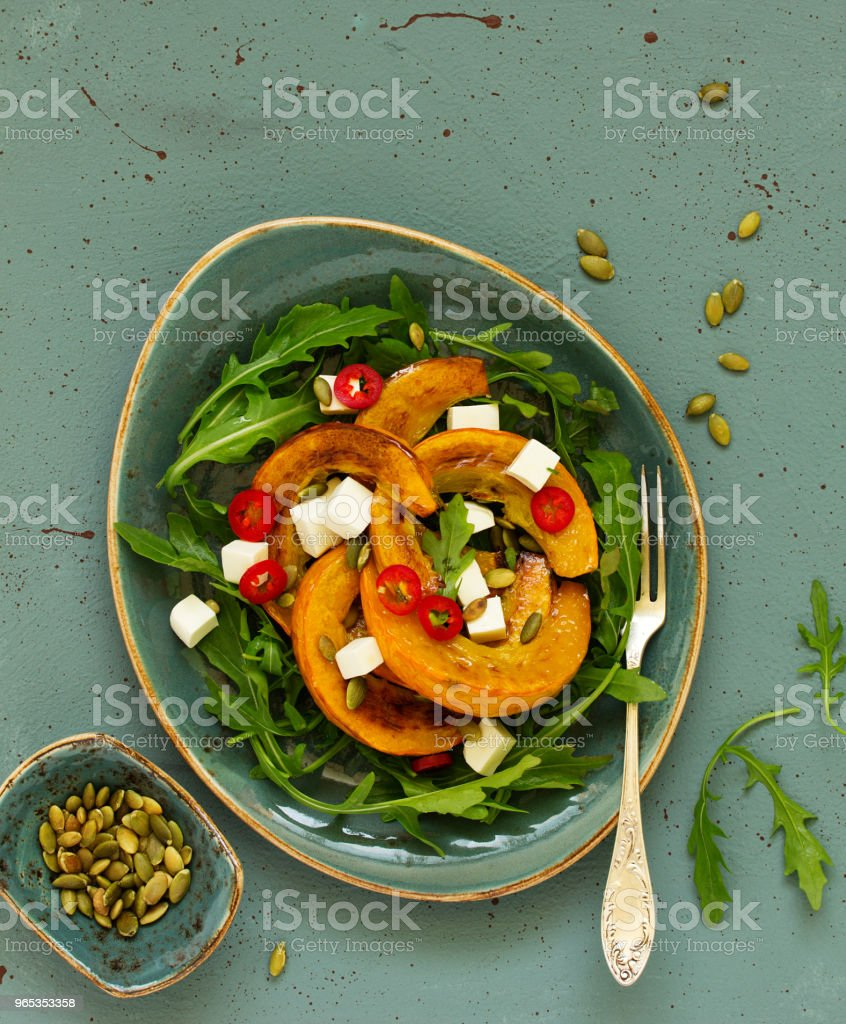 Salad with slices of baked pumpkin, feta, pepper. zbiór zdjęć royalty-free