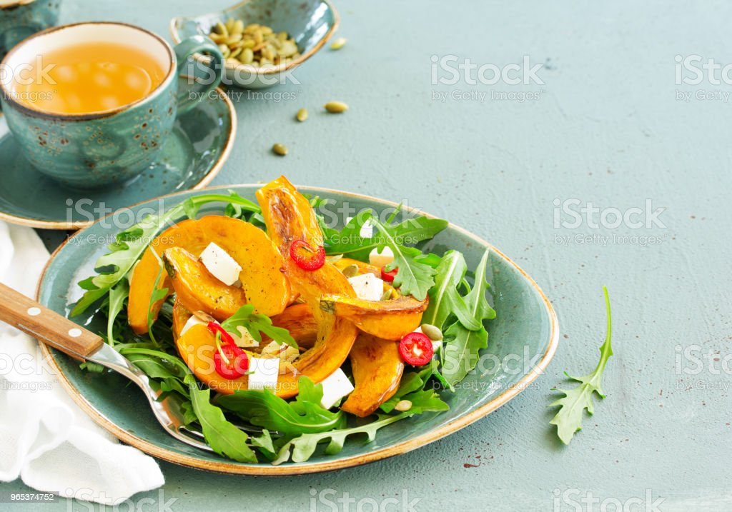 Salad with slices of baked pumpkin, feta, pepper. royalty-free stock photo