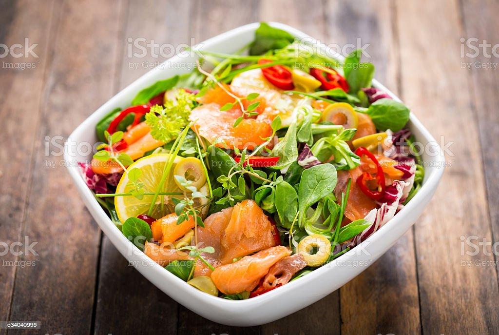 Salad with smoked salmon and lemon stock photo