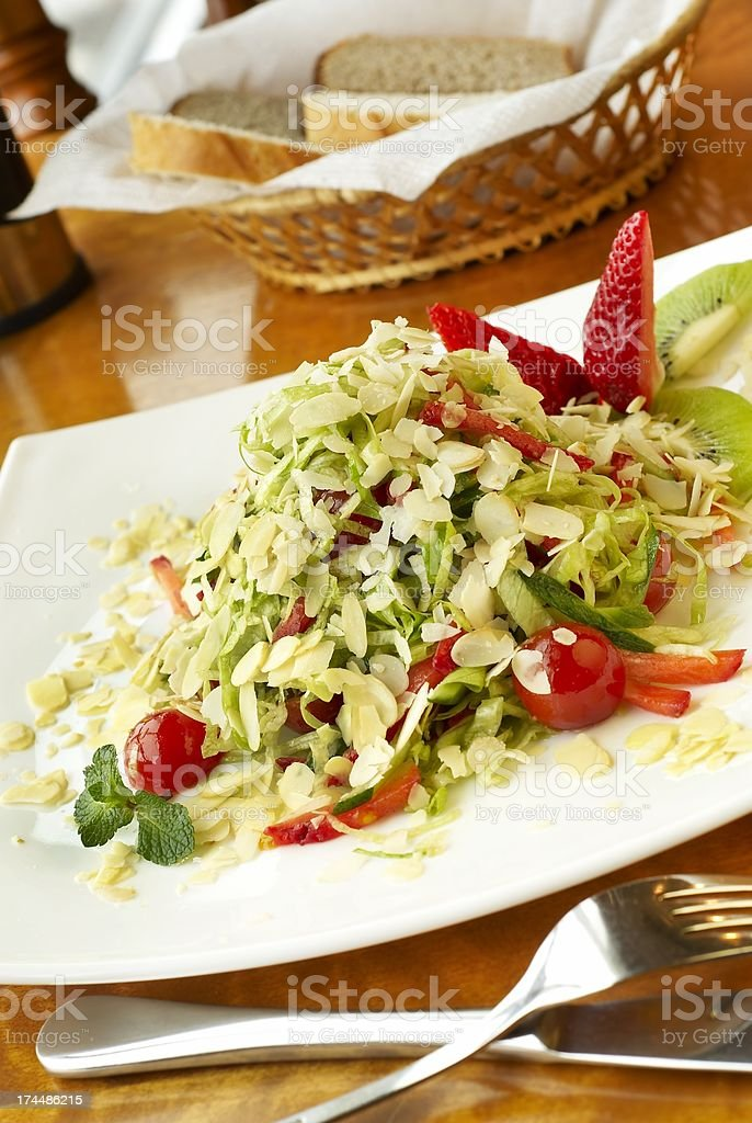 Salad with strawberry, kiwi and almond petals royalty-free stock photo