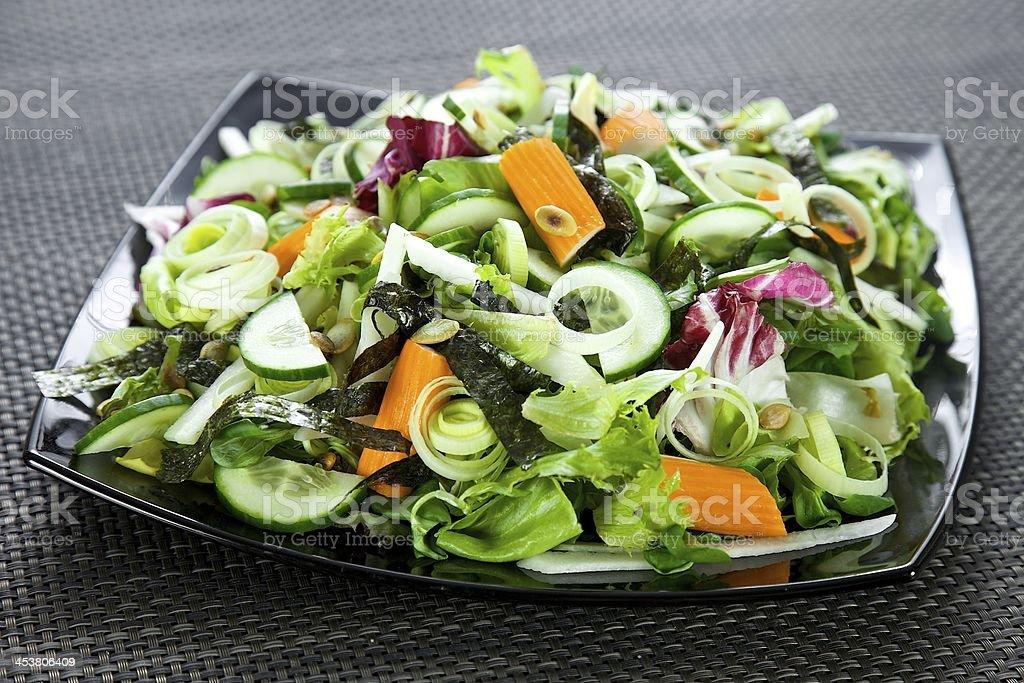 salad with surimi, nori, cucumber and leek stock photo