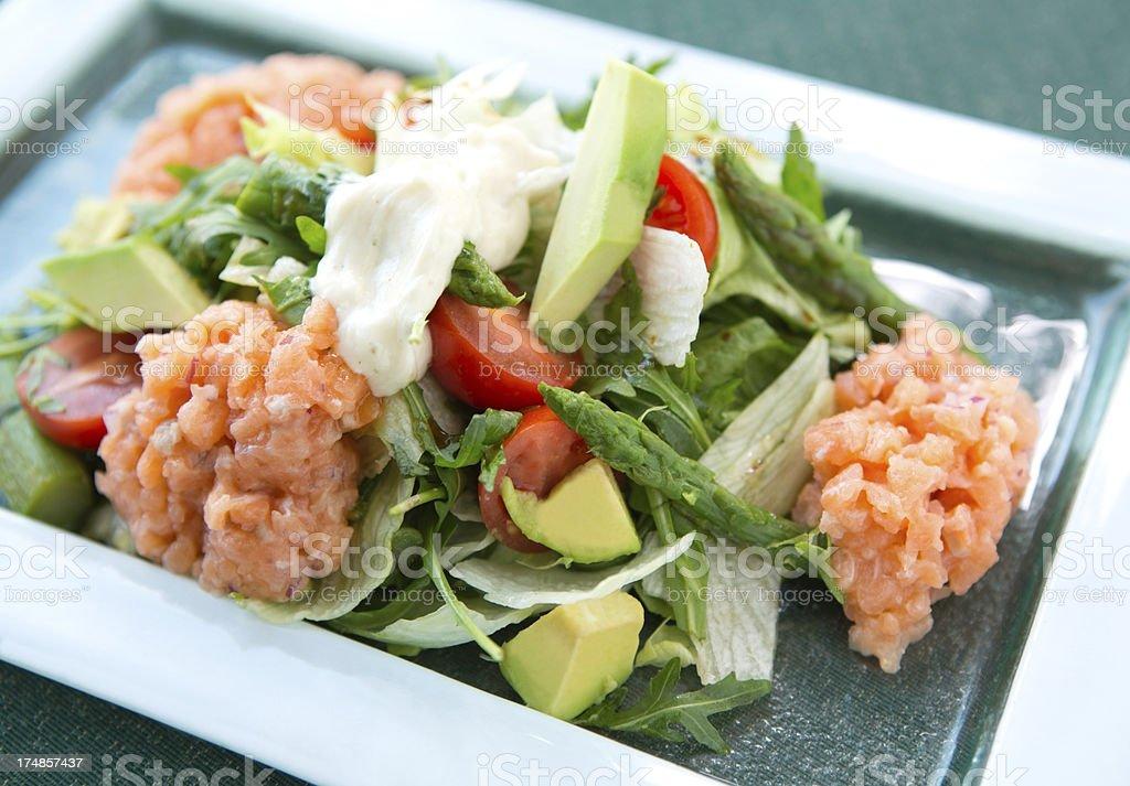 Salad with tatar salmon. royalty-free stock photo