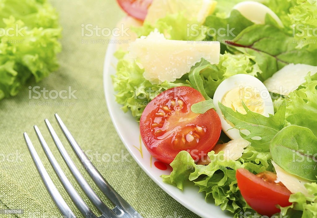salad with tomato, quail eggs in a white bowl royalty-free stock photo
