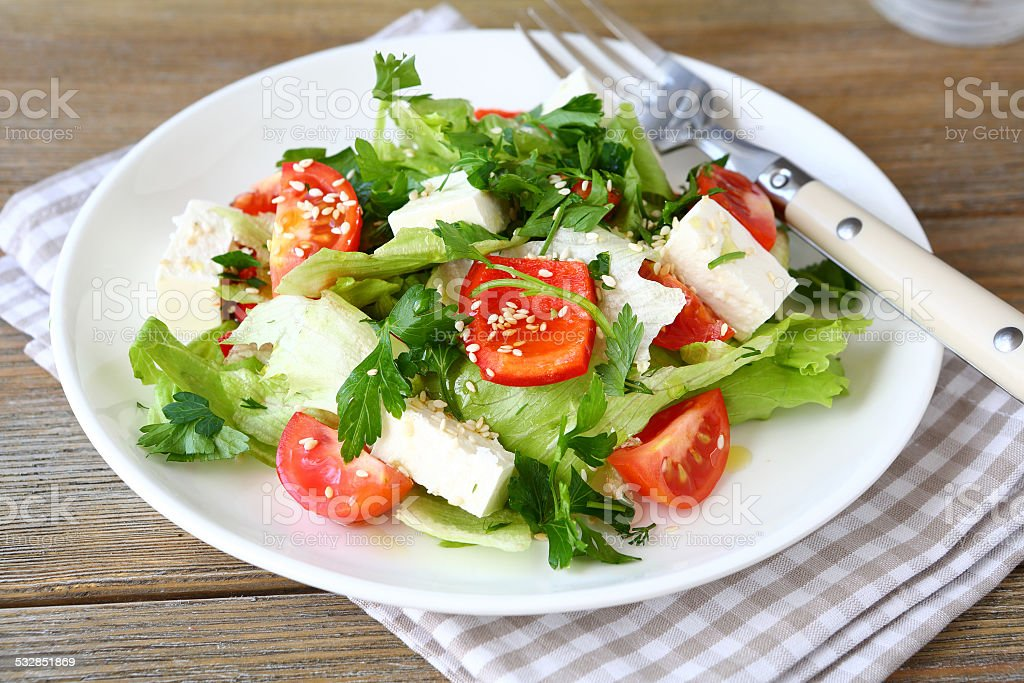 Salad with tomatoes, peppers and cheese stock photo