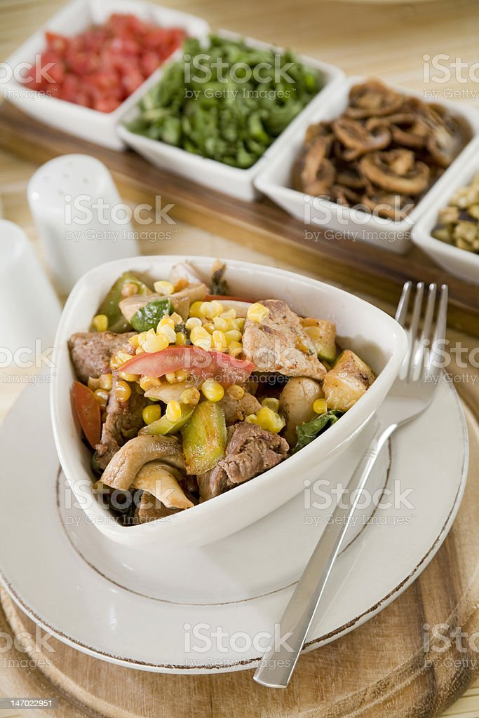 Salad with various meat, corn, mushroom and pepper royalty-free stock photo