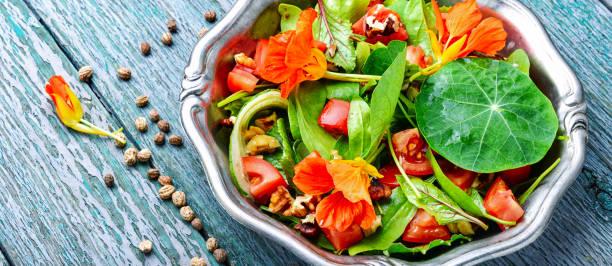 salad with vegetables and nasturtium - nasturtium stock photos and pictures