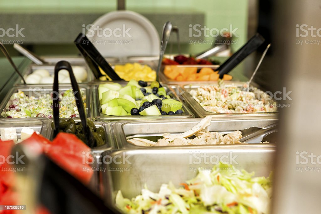 Salads and fruits in a buffet royalty-free stock photo
