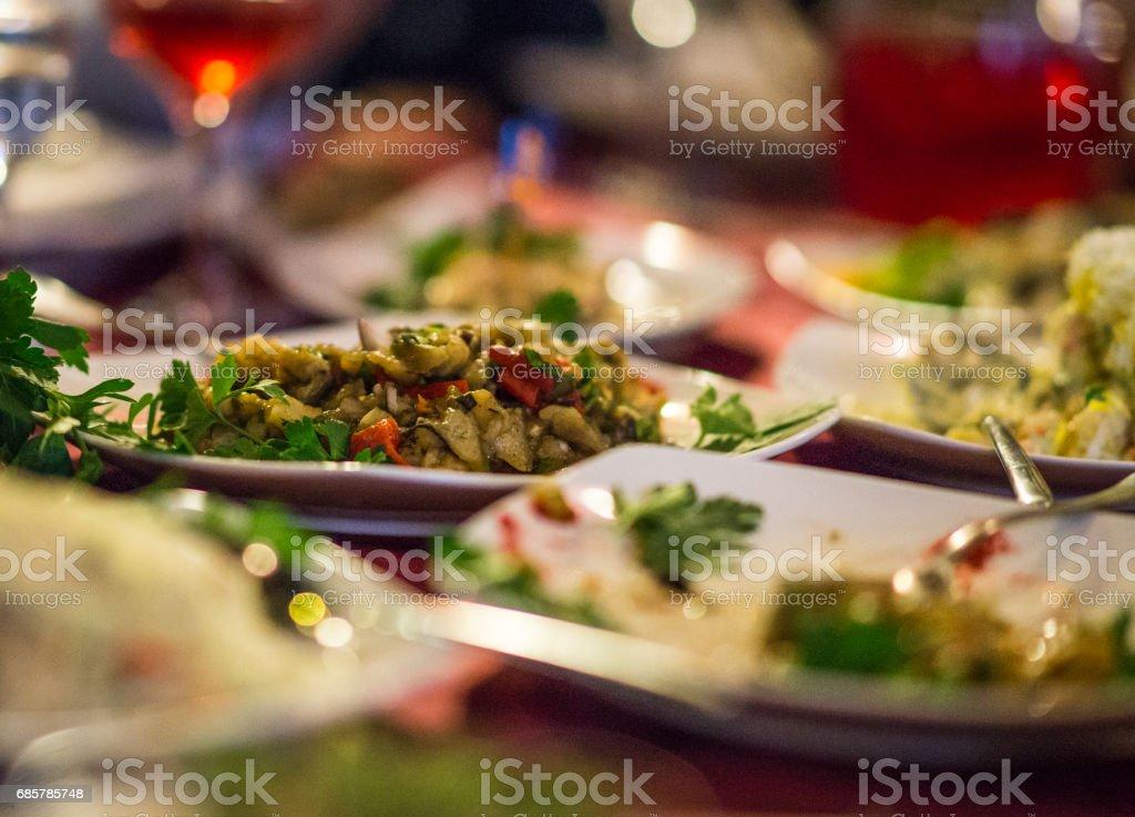 Salads and plates with appetizers on a festive table foto de stock libre de derechos
