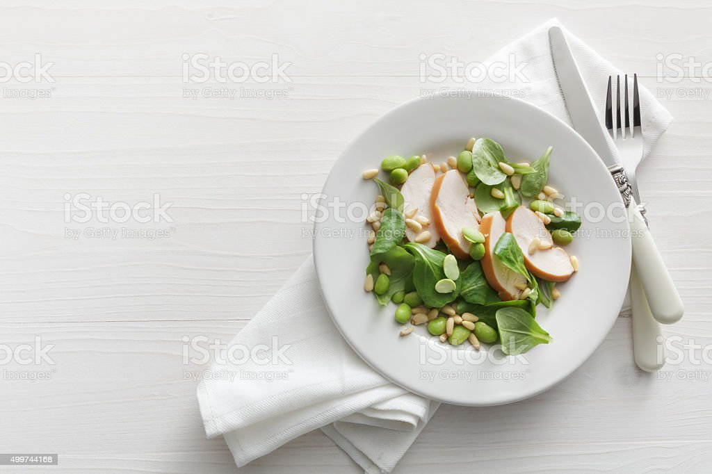 Salads: Chicken, Corn Salad, Soy Beans and Pine Nuts stock photo