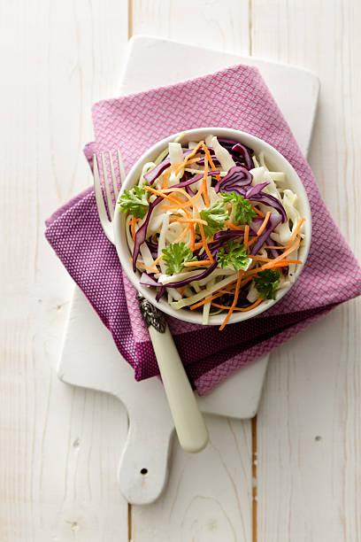 salads: coleslaw still life - coleslaw stock pictures, royalty-free photos & images