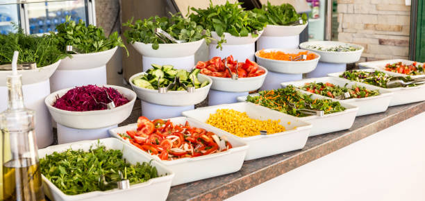 Salads Variety of fresh salads in a buffet buffet stock pictures, royalty-free photos & images