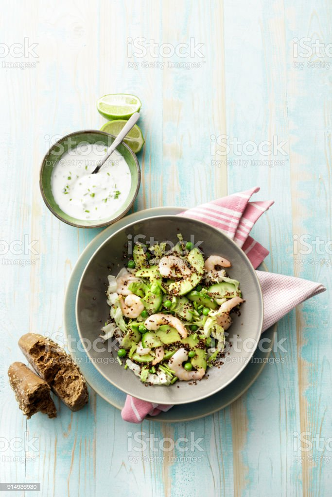 Salads: Quinoa Salad with Shrimps, Avocado, Iceberg Lettuce, Peas and Chives stock photo