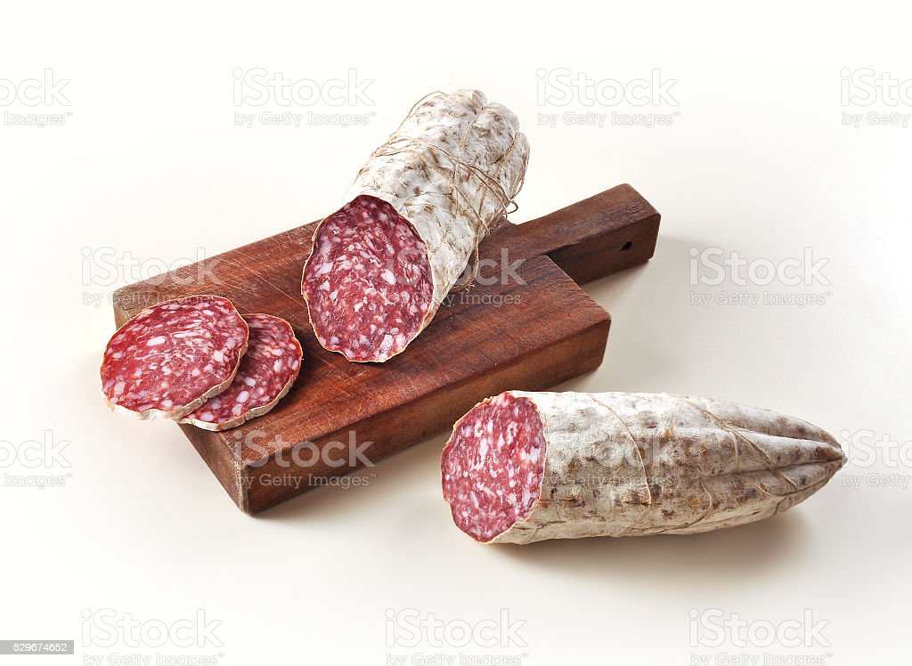 Salame on cutting board stock photo