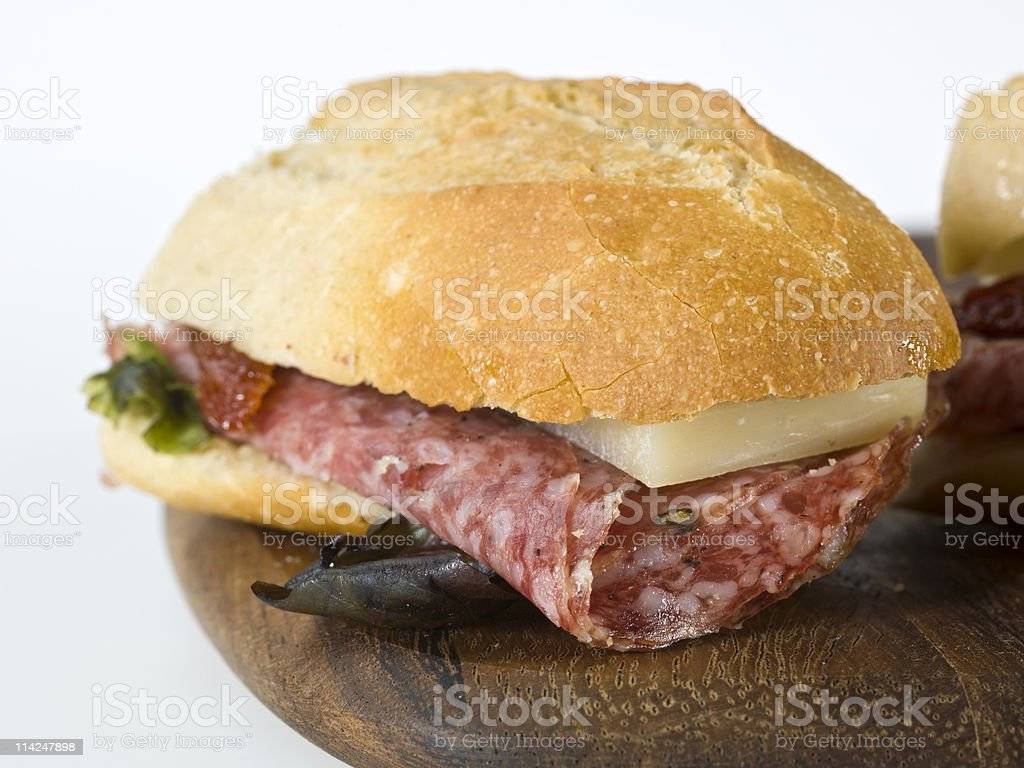 Salami and aged provolone cheese sandwich stock photo