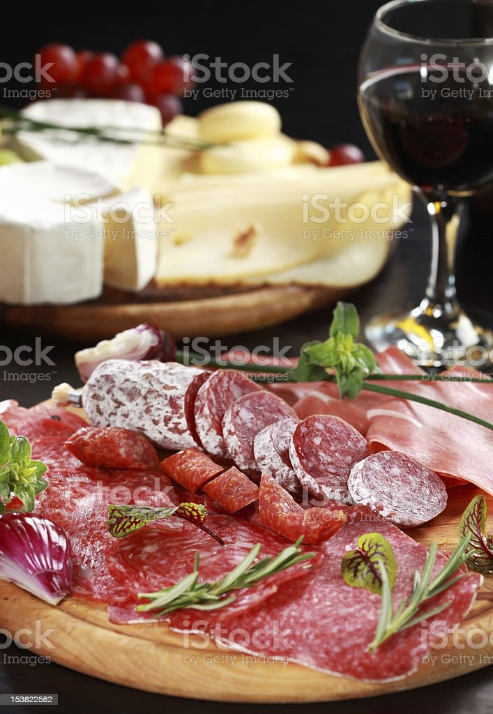 Salami and cheese platter with herbs royalty-free stock photo