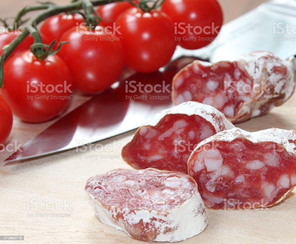 Salami and tomatoes stock photo
