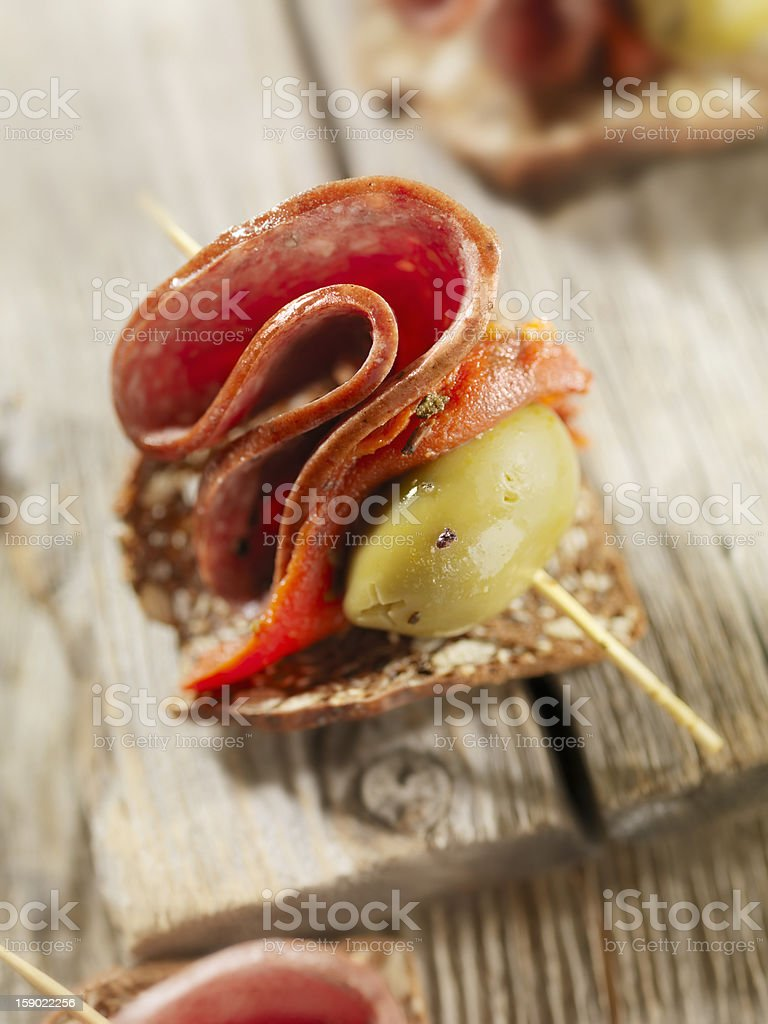 Salami Canapes with Roasted Peppers royalty-free stock photo