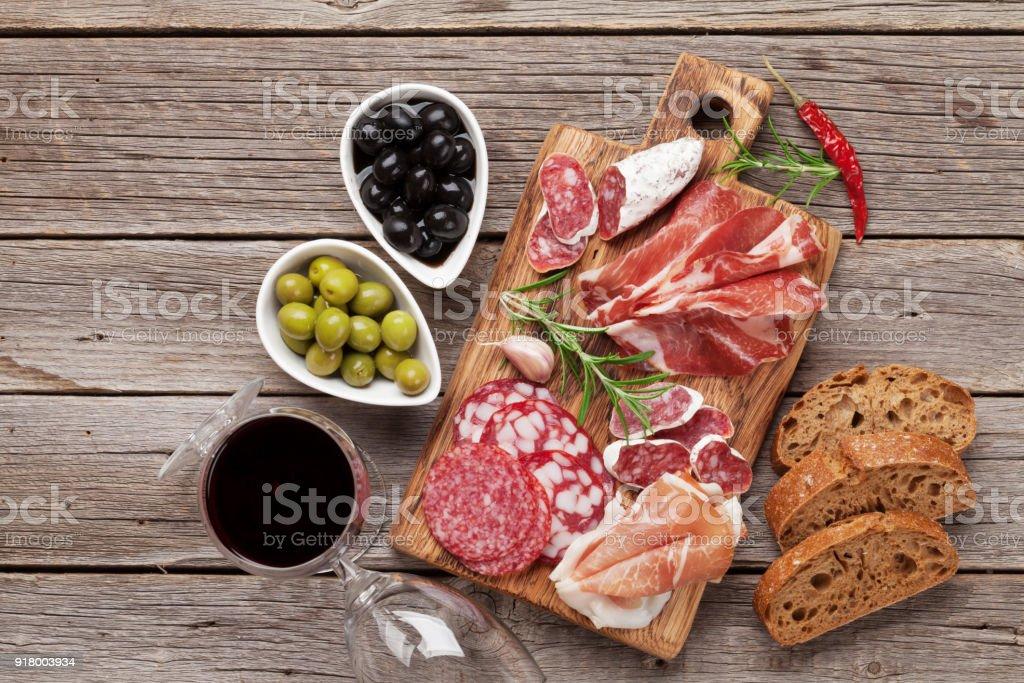 Salami, ham, sausage, prosciutto and wine stock photo