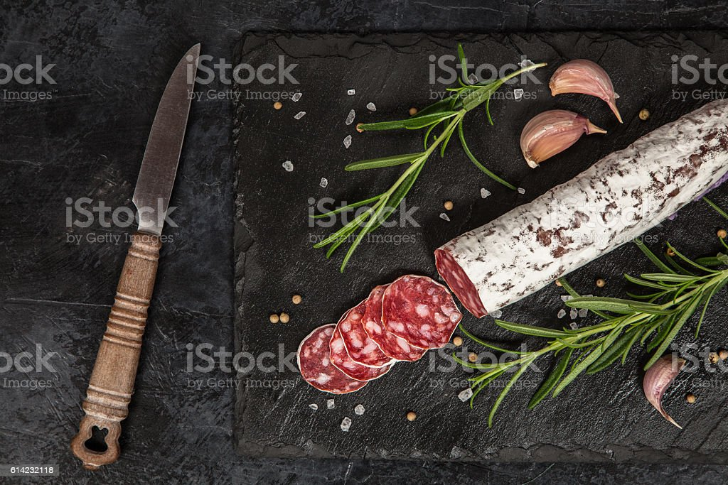 Salami on dark background stock photo