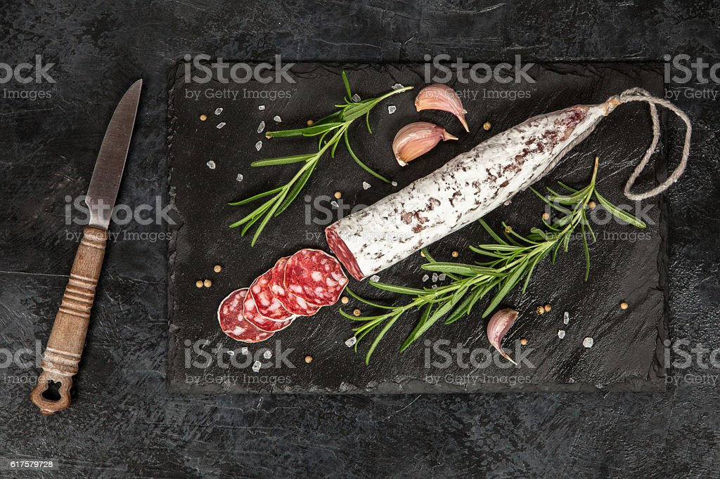 Salami on dark background stock photo