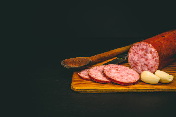 Salami sausage and garlic with peelings stock photo