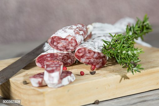 Salami sausage with homemade pepper on a cutting board