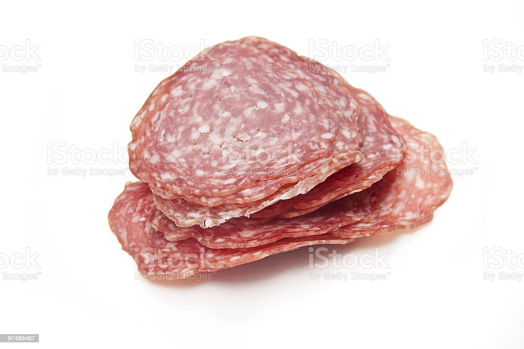 Salami sliced isolated on a white background. royalty-free stock photo