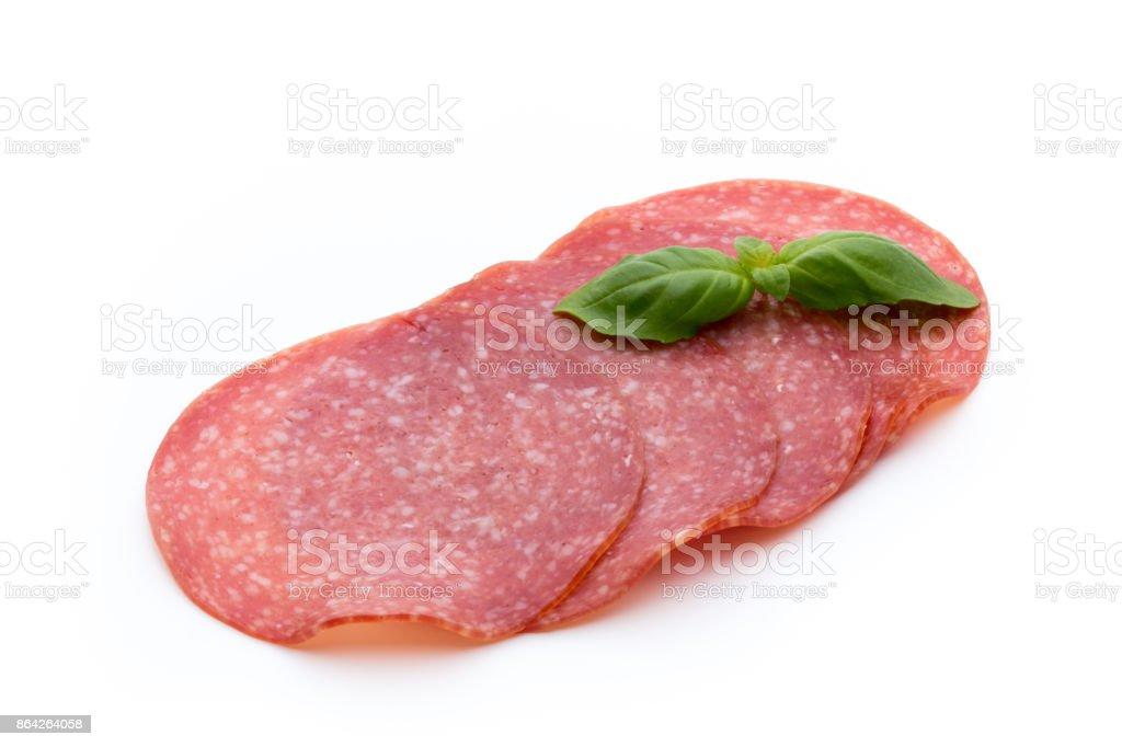 Salami slices isolated on white background. royalty-free stock photo