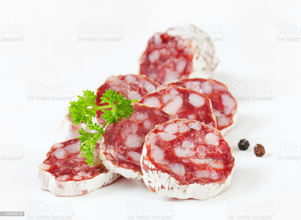 salami slices with spices royalty-free stock photo